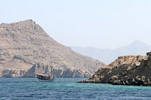 A dhow in the crystal blue waters of Musandam