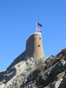 The Omani flag flying from Al Mirani fort in Old Muscat