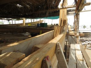 A traditional dhow being built in the shipyard in Sur