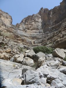 A view of the towering canyon walls of Wadi Ghul