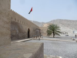 The entrance to to Khasab fort with the Omani flag flying above the gate