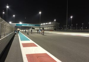 A group of cyclists on the Yas Marina circuit at night