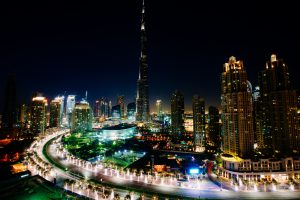 The buildings of Dubai lit up at night