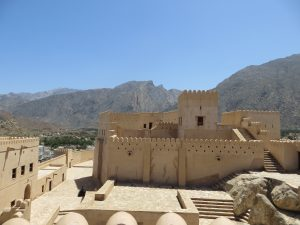 A view of Nakhl fort with the Al Hajar mountains in the background