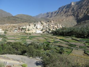 The village of Bilad Sayt can be seen at the foot of the Al Hajar mountains